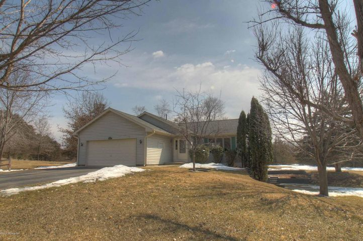 This home has great curb appeal with a park-like front yard and private backyard. It has a walk-out basement and it is almost 1/2 acre.