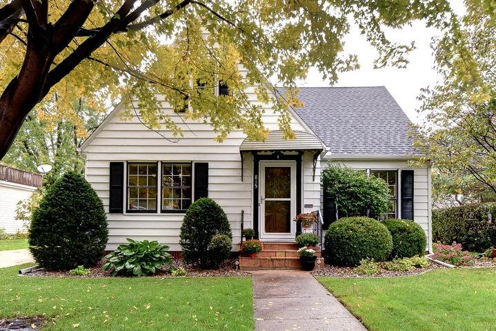 Charming home with mature landscaping and gardens!