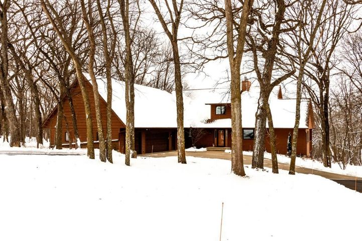 Tucked into 6 acres of woods and meadow, this residence will delight in every season