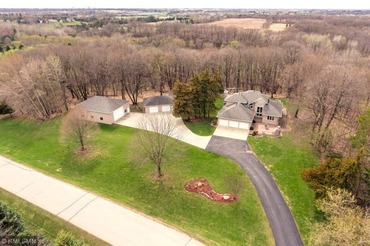 Stunning home on over 3 private acres with outbuildings - just minutes to Rochester!