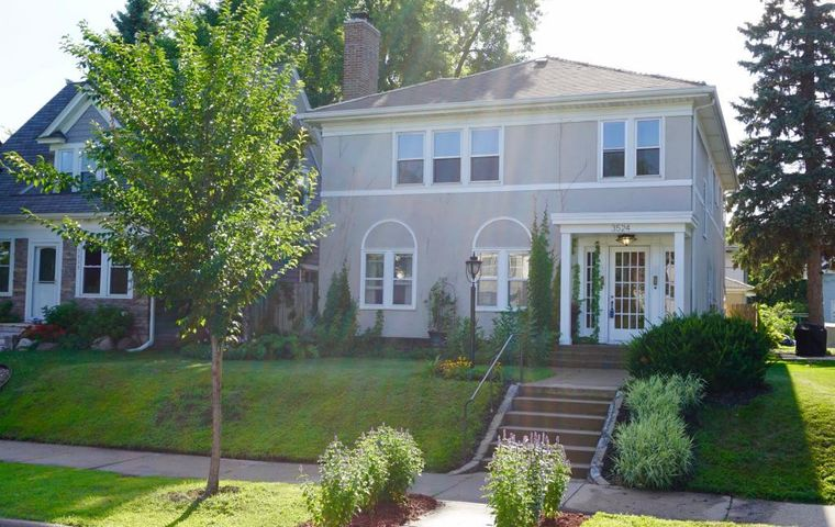 Classic 20's stucco duplex with recently updated mechanicals