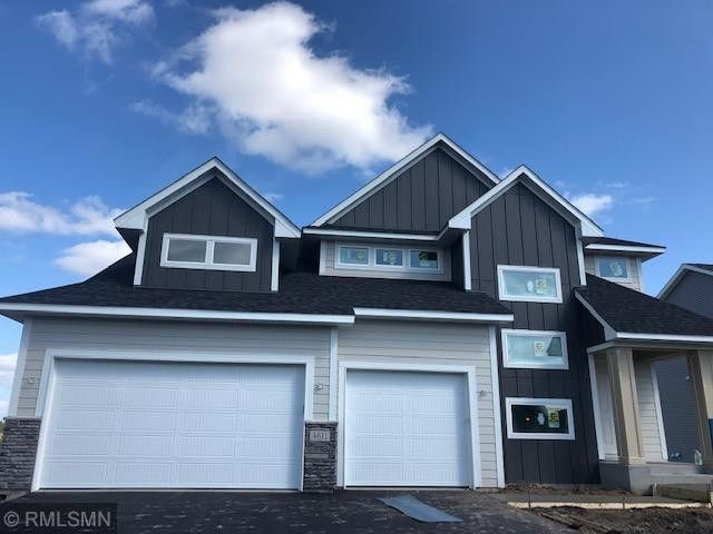 Front elevation features upgrades siding with stone accents. Landscaping, sprinkler system and fully sodded yard included.