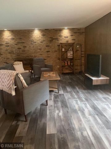 All new flooring in great room with 450+ finished square feet! Gas fireplace insert to be installed prior to closing. Farmhouse style flooring, decor, bookcases and other furnishings all included at list price! Various ways to set up room as shown!