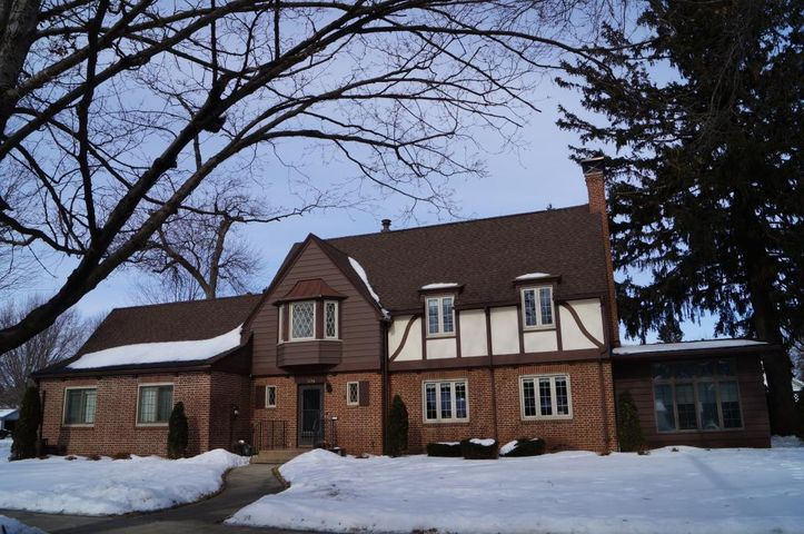 Front of home, beautiful brick work, newer roof, updated windows throughout