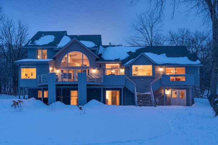 Custom designed home rests on a private 1.2 acre lot with 140 feet of level lakeshore. A tremendous value on Lake Minnetonka!