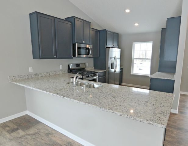 Smart & useful, the kitchen is one of performance and boasts a stainless steel appliance package which includes a gas range, refrigerator, dishwasher and vented microwave - all surrounded by glowing granite countertops!