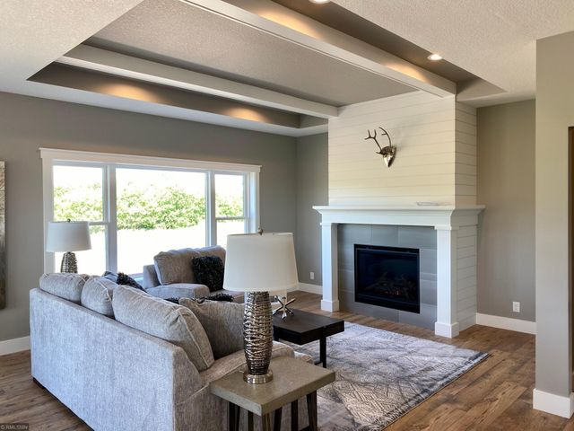 New construction spec home with custom features! Notice the tray ceiling with wood beams.