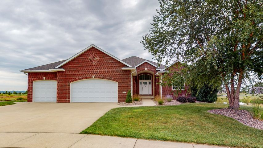 Welcome to 123 Emerald Lake Dr. This home boasts a beautiful brick exterior with walkway up to new front door with large entry way and is newly landscaped. 3,180 finished square feet.