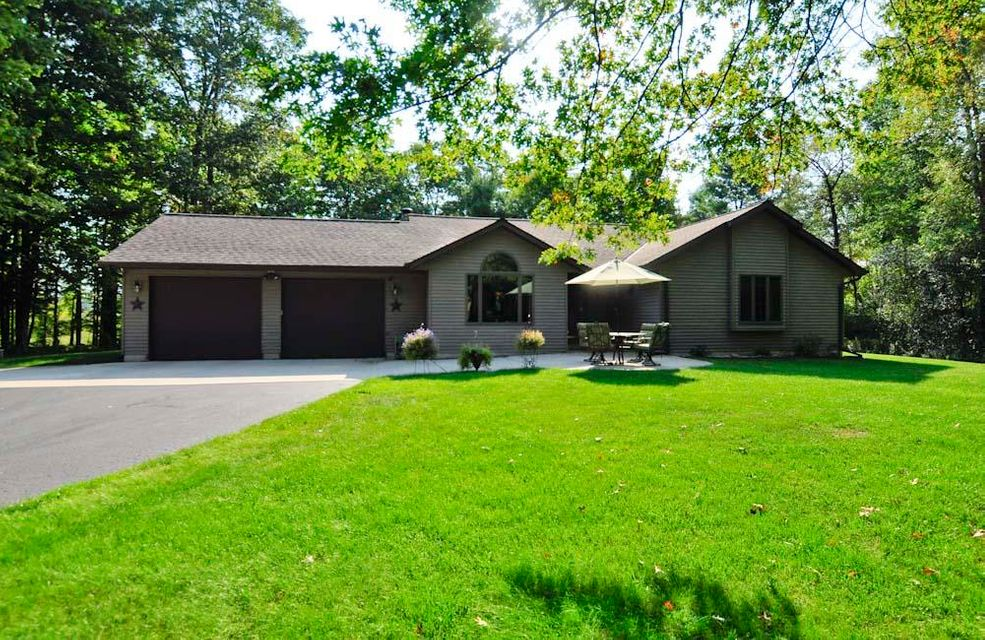 Marinette Country Waterfront Ranch with over 4 acres and 374 feet of Menominee River Frontage! Two miles from town boasts this 3Bdr/3Bth ranch w/full walk out lower level. Oak wd trim, doors, floors, cabinets,wd burning fp, master bath, KT with workng island and dinette w/large picture window for your viewing pleasure of the beautiful private landscape. Tranquil setting with wooded backdrop in secluded sub division. Peaceful frontage w/dock. Attached garage,detached garage and additional two story finished garage. HOA of 75.00 pr year, includes gated common area park like setting w/dock for your use. Deck 16x24, Automatic generator, natural gas, c air is newer, roof is only 10 yrs old.