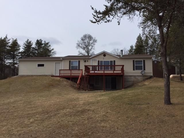 front of house with 16 x 16 deck, walk out basement with patio doors