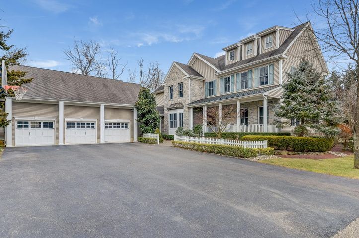 Stately Custom Colonial-3 Car Garage and Full Caretakers Apartment Above