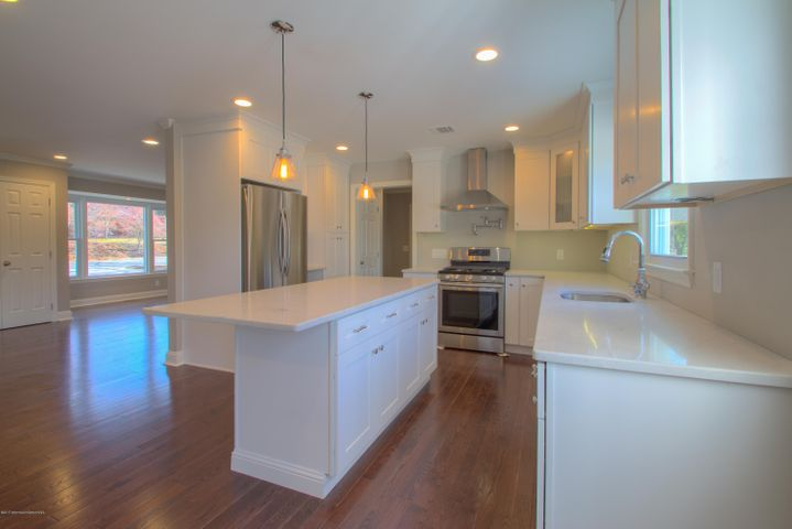 Fabulous Kitchen layout and finishing touches. All new SS appliances, SS stove hood, Pendant lights with vintage look,