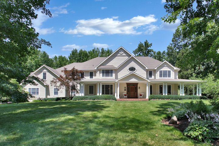 Casual elegant colonial with open floor plan for entertaining year round and close to ferry to NY, GSP, train, and beaches!