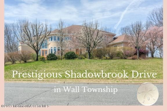 Welcome home to 2110 Shadowbrook Drive - one ov Wall Township's most prestigious streets...