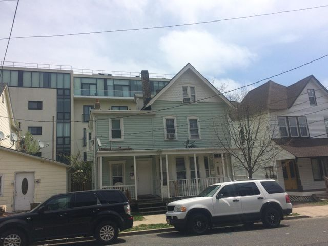 Large multi-family near the downtown in need of renovation. Only 2 1/2  blocks to Cookman Avenue filled with shops and restaurants. Private driveway with room for at least 2 cars. One bedroom apartment on one side and 5 bedroom on other. New roof just installed. All utilities separated except sewer.  Great location delivered vacant.