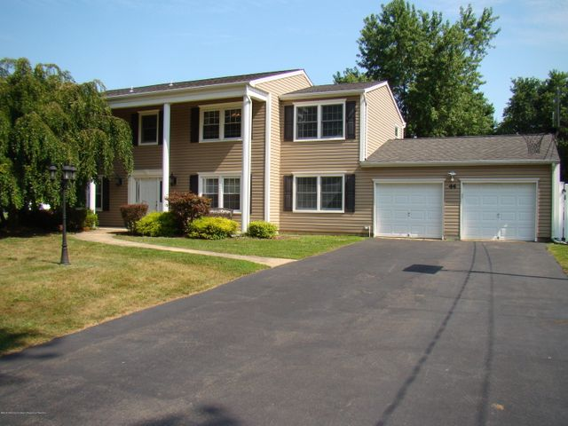 Large 4 bedroom 2 1/2 Bath Colonial with Newer Roof, Siding, & Windows