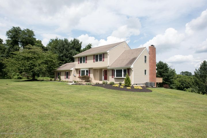 Situated on 2+ acres with Green Acres surrounding 2 sides