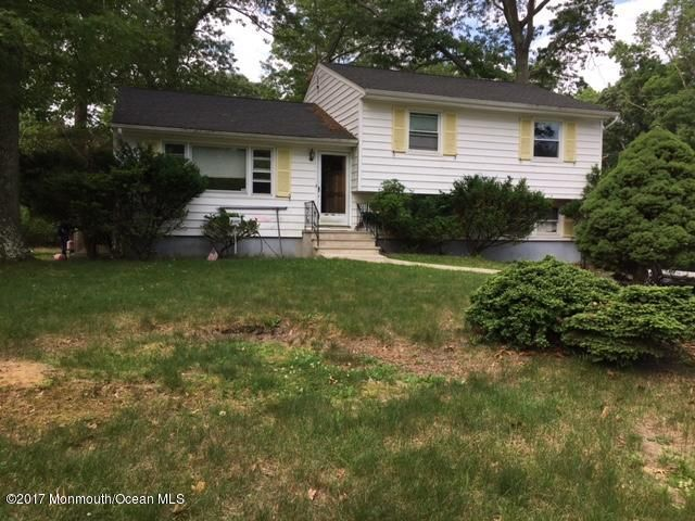 Huge property (half an acre) on lovely, quiet block. House is maintained/ functional but needs some cosmetic updating. Split level home with kitchen, dining rm and living rm on entrance level. Upper level has 3 BRs and full bath. Lower level has den, bedroom, 3/4 bath, laundry and mudroom/side entrance. Basement has an egress window and is a legal 5th bedroom (semi-finished).Super sized driveway. Walk to houses of worship. Room to create backyard oasis with pool, sports courts, etc. Rare beautiful property-walk into Weltz County Park from your backyard, with private wooded walking paths-fantastic for walking dogs, visiting whale pond brook. New roof, maintenance-free siding, and new hot water heater. Beautiful hardwood floors.