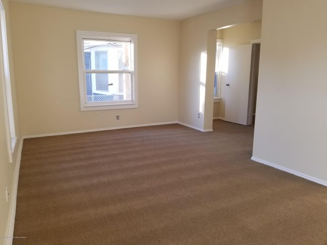NE Asbury 3 bed 1 bath apartment annual rental. All utilities included (except cable/internet), exclusive use of driveway, eat in kitchen, shared front porch and back yard. Short walk to beach and downtown.Unit will be freshly painted and have new carpet for next renter.  NO PETS NO SMOKING.