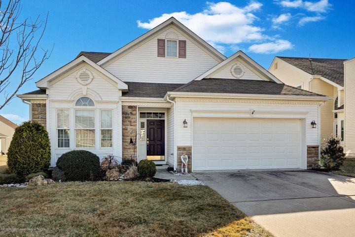 This Beautiful Three Bedrm Southwind Model w/Loft and Backs Up To Woods. Offers Gourmet Kitchen w/Stone C/Tops, Double Ovens, Cook Top Range, Under Counter Lighting, Appliances, Dinette, Family Rm w/Vaulted Ceilings, Recessed Lighting, Living & Dining Rm. w/Decorative Moldings. Sunroom w/Vaulted Ceilings & Sliding Doors To Paver Patio. Master Bedroom w/Full Bath & Walk-in Closet. Master Bath w/D.S. Vanity, Soaking Tub & Stall Shower. Second Flr. Loft w/3rd Bedrm, Full Bath & Lots of Closets. All Window Blinds, Ceiling Fans, 2 Car Garage. Paver Patio. Located in Greenbriar Oceanaire Golf & Country Club w/18 Hole Golf Course, Clubhouse, In & Outdoor Pools, Restaurant & Pub. Fitness Center and Much More.
