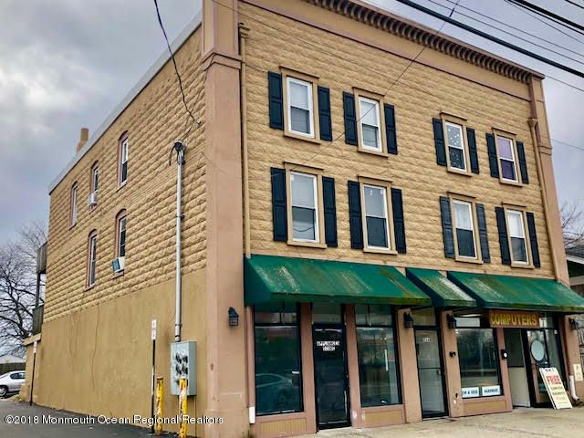 Great Location on this 6 Unit Building. Four Apartments, 3-3 bedroom units and one 2 bedroom.. 2 storefronts and parking lot in rear. Good opportunity and priced well. Tenants pay there own gas and electric in each unit . Landlord pays Water $1,630, sewer $1,200 and insurance $3,500..