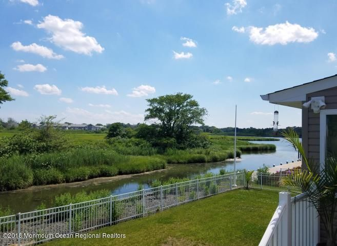 Wonderful waterfront retreat - all newly renovated. Located in desirable Monmouth Beach. Enjoy water views from almost every room and spend time in the beautiful all weather sunroom overlooking the river. Open floor plan makes for great gatherings and entertaining. Gleaming bamboo floors, marble and ceramic baths, granite counters, 2 zone heat and air. Just a few blocks to the beach and town. Home is offered for either the month of July or August for $12,000. Owners will consider shorter term as well. Pls no pets smokers.