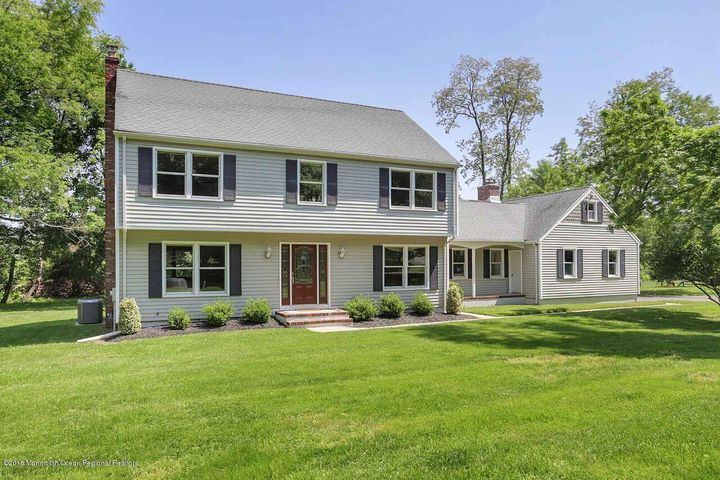 Colts Neck Reservoir Section Center Hall Colonial featuring 4 bedrooms and 2.5 baths