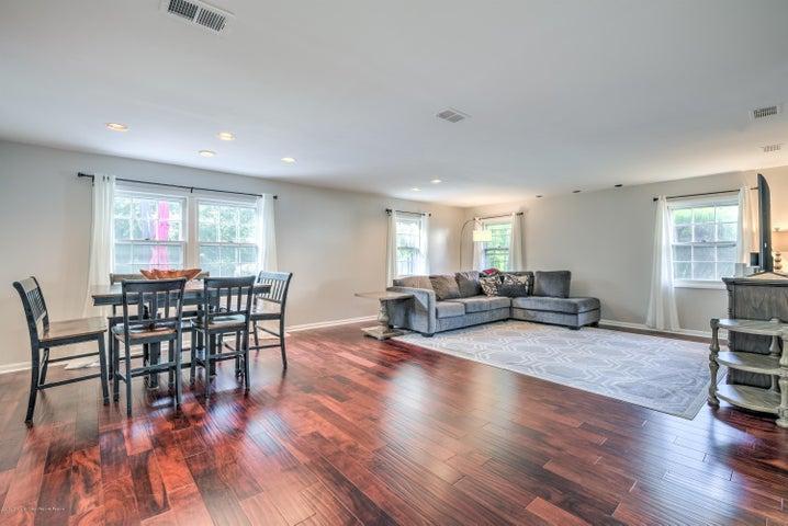 Beautiful open floor plan, stunning wood floors.