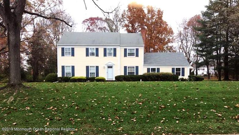Classic 5 Bedroom Colts Neck Colonial with HardWood Floors throughout on over 1.3 private level acres with room for expansion.