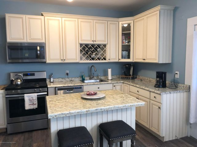 Updated kitchen with stainless appliances and center island