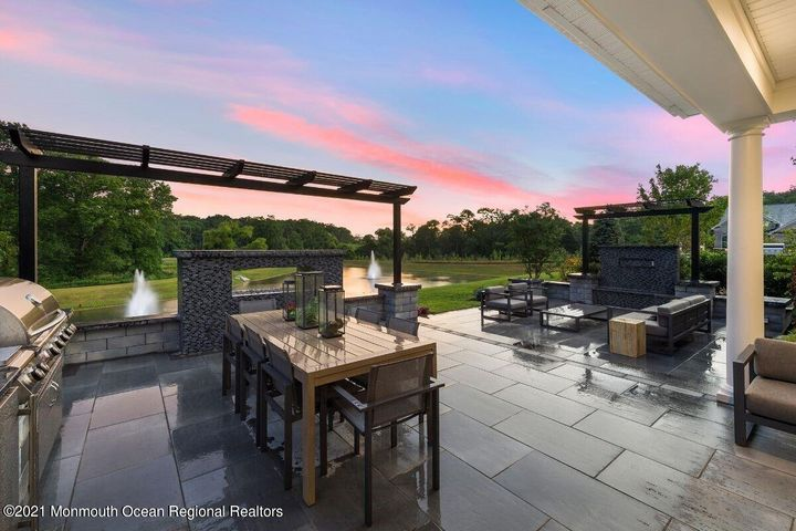 Sunset views over the pond from your relaxing outdoor living space
