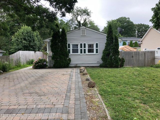 Unpack and enjoy this home & beautiful front yard with large double paver driveway.