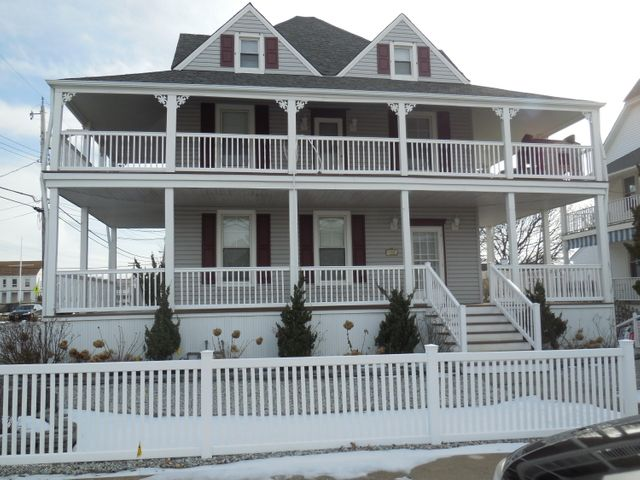 Enjoy the Winter, Spring, Summer and Fall in this magnificent Victorian with 2 wrap-around porches. This home is only 2 short blocks to the boardwalk & beach. Soak in the ocean views and breezes from the open porches. A total of 5 bedrooms, 4 have queen beds. The 5th bedroom has twin beds.  There is a full size futon in the third floor living room. In all the home sleeps 12.  There are living rooms on each of the 3 levels.  There are full bathrooms on all levels.  A tub/shower on level 1 and stall showers on level 2 & 3.  The first & second floors have fully equip kitchens with dining areas plus washers & dryers which makes it perfect for extended families & friends.  Rental prices vary seasonally.  Short term rentals are preferred. Listing price is the 2020 Summer rate per week.  There is a minimum of a 3 night stay per week during the off season.