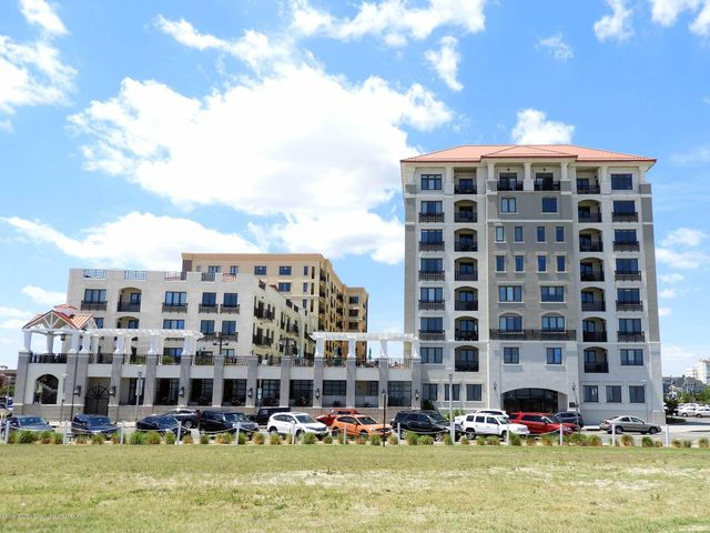 FALL/WINTER 6 MONTH RENTAL.  Live along the shore in luxury in the desired North Beach oceanfront complex.  Bright and sunny this clean, spacious and full turn key open concept 2 bedroom/2 bath condo features all brand new furnishings thru out this professionally decorated penthouse.  Enjoy plentiful sea breezes and slight ocean views from your south and west facing wrap around windows.  Entertain in your chef's kitchen or relax in your den or living room.  Large master bedroom has an en suite master bath complete with soaking tub and shower combo.  Complex features fully equipped gym, meeting rooms, concierge, covered parking spot, pool and hot tub.  Steps from Asbury Park restaurants, shops, bars, galleries, boardwalk and beach.   Cable and wi fi included.