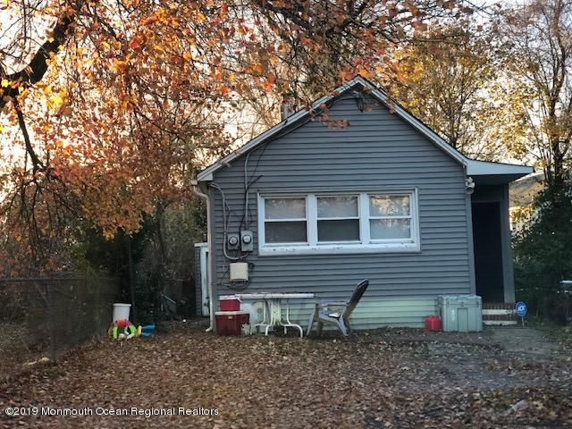 Opportunity Knocks ...for prepared investor. Buy and hold or fix and flip.  First time homebuyers too can invest and live affordably with cosmetic renovations.  Exterior has already been overhauled.  New siding, new roof are both approximately 2 years old.  A little curb appeal and landscaping, and interior TLC will go a long way in this neatly nestled 2 bedroom home.  A little imagination can manifest open concept and smart color scheme. Sleek new kitchen and rejuvenate bath and floors is all it will take to have a desirable and welcoming space.  Don't wait ...Now is a good time to initiate.
