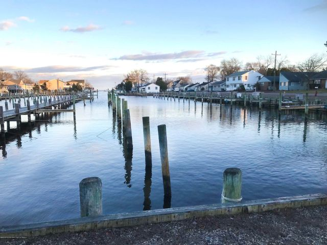 Live the dream with this opportunity to own your own marina! Located on the protected South Harbor Lagoon in Waretown, NJ. with direct access to the Barnegat Bay and the intracoastal waterway. Located across the bay from the Barnegat Inlet, less than a 15 minute boat ride from the Atlantic Ocean.130+ slips for boats up to 50 feet, with direct parking behind most boat slips, offering your boaters convenient, quiet and uninterrupted use of their boat. Mens/womens restrooms, picnic area, bbq grills, trash disposal, 30-amp metered electric and dockside water. Perfect location for skiers, cruisers or fishermen. Neighboring marina is full service with fuel and repair. Possible Seller financing available. Amazing opportunity for passive income. Avid boater? Buy the marina! Current return is approx 5% with opportunity for much higher.