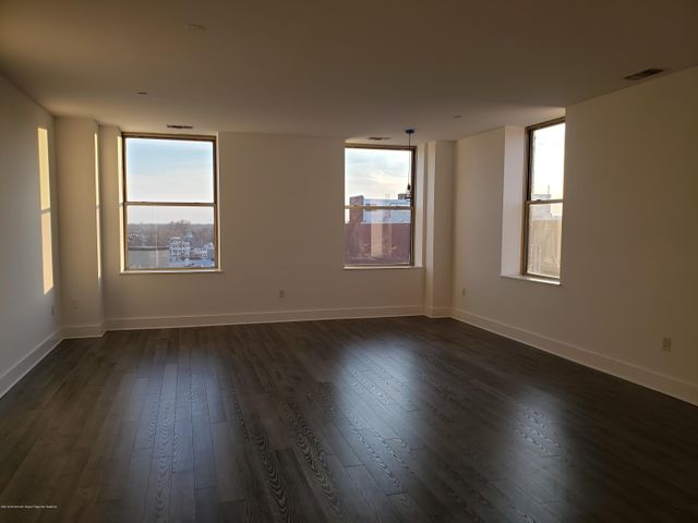 Downtown Asbury Penthouse Apartment. Modern, spacious 1500 + sq ft 1 bed-2 bath annual rental, just around the corner of Cookman ave, and 3 blocks to the beach. Open floor plan with office area (which could be sectioned off as second bedroom), 9 ft ceilings, large windows provide lots of light and great city views, engineered wood floors throughout, stainless appliances, jetted bathtub. washer/dryer. Includes one gated off street parking spot. Building has elevator and gym.
