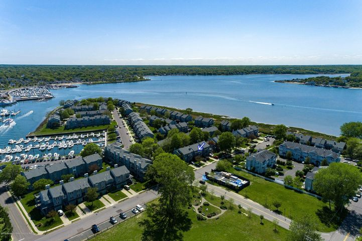 SHORE LIVING AT ITS BEST! Nothing to do but unpack in this 2 bedroom + family room townhome on glorious Seaview Island. Enjoy water views & resort lifestyle. This sunny unit offers 3 floors of living, 3.5 baths & $50k in updates. A spacious eat-in kitchen has granite counters with new appliances that opens to dining room & step-down living room w/fireplace. Wood floors throughout and built ins. NEW: HVAC system; Maytag washer; windows; interior/exterior light fixtures. Each bedroom & family room have full baths + large closets. Master closet is cedar lined. Family room has attractive Murphy Bed; completely renovated with high-end flooring and new accessible bathroom. Attached garage with storage. Exterior siding project underway adds great value to this home! Enjoy BBQ's and entertaining on the paver patio off the downstairs family room. Minutes to the beach and boardwalk, Asbury Park, restaurants, and close to major roadways for an easy commute. Call for an appointment today! Take a virtual tour: https://vimeo.com/423329623