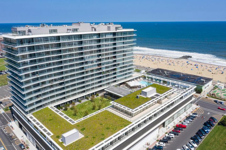 Enjoy oceanfront, resort style living in the Asbury Ocean Club Residences. This 2 bedroom/2 bath luxury oceanfront condo features amazing ocean views and abundant sunshine thru your floor to ceiling glass walls. Enjoy cool ocean breezes from your private outdoor room and balcony living space.  Unit #1003 offers an open floor plan, with a center island and entertaining kitchen, master bedroom with en suite bath, fully  equipped with designer furnishings and all that you need to enjoy a one-of-a-kind experience.   The Asbury Ocean Club developed by iStar and completed in 2020 is a 17 story tower with 130 condos and a 5 star service boutique hotel on the 4th floor. Residents have access to exceptional amenities including a heated pool, fire pit and hotel and concierge services, including  room service. The third floor amenities space consist of a fitness center, spa with massage and facials, a cinema room, business center/conference room, a dining room with a private chef table, game room with pool table, a kids play room and a dog washing station.