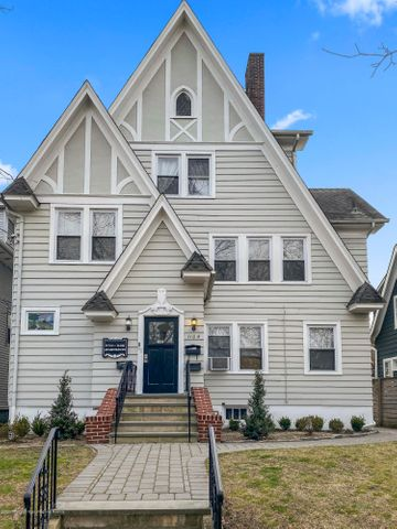 One of a kind Tudor style, beautifully maintained 6 family building. Five apartments in front with separate 3 car  garage apartment in rear with alley access. 3 apartments have fire places, all have hardwood floors and lots of charm. New heating system in 2019, exterior painted in 2019. State inspection up to date.