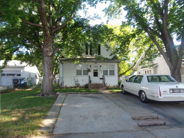 2 concrete driveways in front & parking in the back too. Alley access.