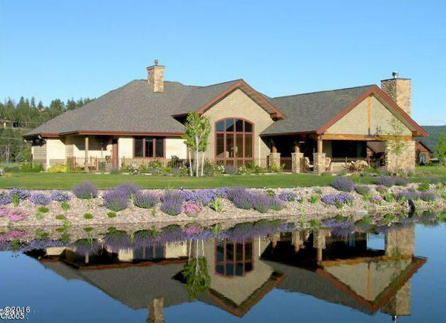 """""""GOLF COURSE LIVING AT IT'S BEST"""" Eagle Bend's Lake Nine Court.  Custom single level quality throughout.  Huge covered patio with fireplace & hot tub.  Beautiful wall-of-windows with tile counters, Alder doors & trim, stone accents & a beautiful fireplace in the great room.  Very spacious with vaulted ceilings & large hallways."""
