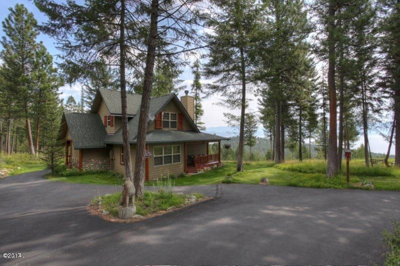 Idyllic 10 acre site overlooking Flathead Lake and the west shore. Built as a roomy 3BR/2BA guest house for the lodge next door, this home is sited on it's own gorgeous 10 acre meadow/tree mix with beautiful benches for another large lodge or additional cabins. It's an ideal horse property with public land nearby for endless recreational possibilities. Views are spectacular from the front porch and master suite deck with sweeping vistas across to Flathead Lake and the Mission/Swan Range. Inside the views are equally awesome looking through the large windows that brighten both levels of this well built home. The main level living area is warmed by a beautiful stone fireplace. Or, build your  own dream Montana home and live in your charming existing guest house during construction.