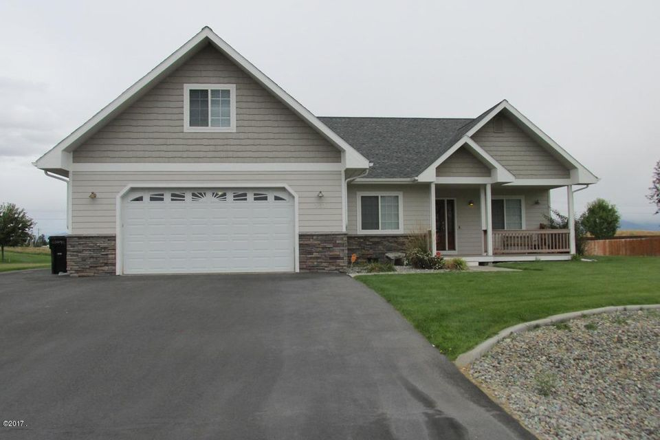 This beautiful 4 bedroom, 2 bath home is very tastefully finished and well cared for. There are 3 bedrooms on the main floor and a bedroom/bonus room on the upper. Open floor plan, vaulted ceilings and an extra room that could be office or formal dining. Also included is an extensive alarm system by Vivent that could be transferred with the home. House has a large yard and spectacular views of the mountains. Lots of open space nearby. To view this lovely property, call your real estate professional or listing broker Laurie Turner @ 406-253-4448