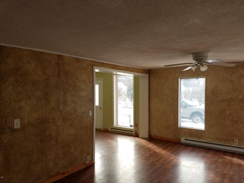 Enjoy the little western town of Eureka Montana in the 2 bedroom home close to all the amenities that Eureka Offers ! A spacious master bedroom, large living room! A bonus room upstairs could be converted to the 3rd bedroom or used as an office and a small unfinished basement has lots of potential as well ! Relax in comfort, In 2016 a minisplit heat pump was installed for heat and AC. There are nice trees around the property and a garage with a woodstove and work bench ready for your projects. Possible owner financing with a down payment and approved credit.  For a showing on this affordable Eureka home call listing agent Gideon Yutzy at 406-261-1246 or your Real Estate Professional
