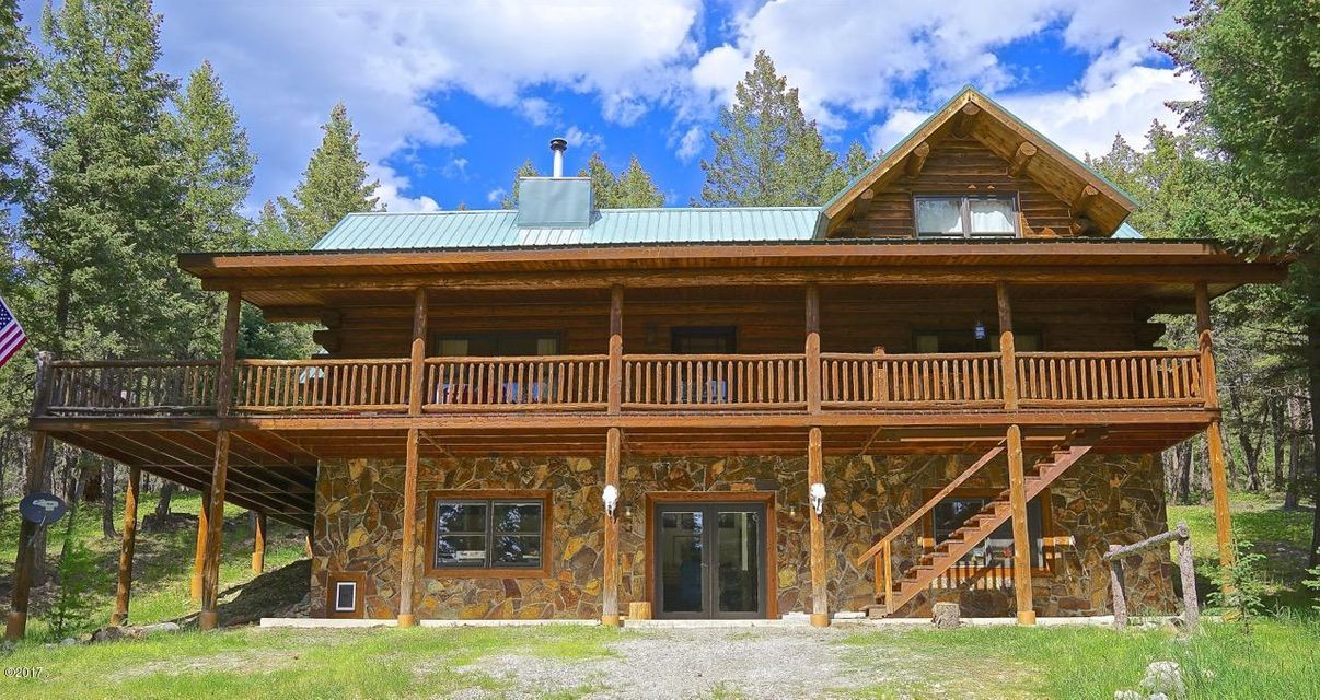 Log Home in Northwest Montana ! Live in one of the most beautiful spots in the country in this quality 3 bed/3 bath log home on 10 acres of quiet, wooded beauty ! This property has a desirable location with a short drive to Eureka and also conveniently located to Whitefish and Kalispell. Whether your interests include, hunting, fishing, hiking, camping,skiing,or just sitting on the front porch sipping iced tea and breathing in the pure air of Montana this property is the one that you can call home sweet home ! The home is built with a variety of decor from the log construction on the main floor and upper level to the English Tudor style  of a part of the basement. You will appreciate the hard work and quality that went into this home !