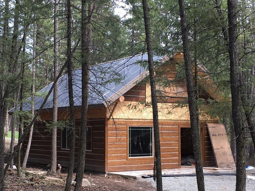Opportunity awaits with this beautiful Montana property, 2 acres with 2 very nice Cabins under construction, both of the cabins are well on their way to completion, roofs are installed  and windows are in and the project is ready for you to wrap up the construction and live life in a beautiful area quite close to the beautiful Lake Koocanusa ! Nicely treed which offers decent privacy. The square footage is equally divided between the 2 cabins with the outside dimensions being 24 ft wide by 32 ft long with an additional loft in each one 12 ft long by 24 ft wide. This would be a great full time residence with a guest cabin or would make a great VRBO ! Call Gideon Yutzy 406-261-1246 or your Real Estate profesional