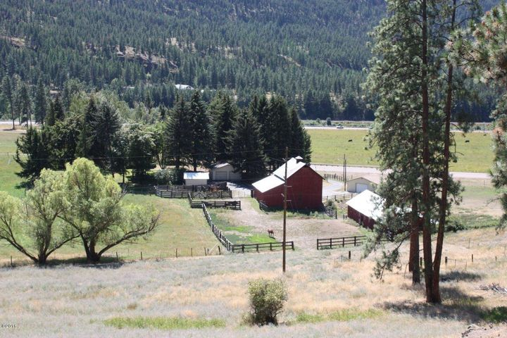 Farm house, detached garage, shop, cow barn, horse barn and corrals.