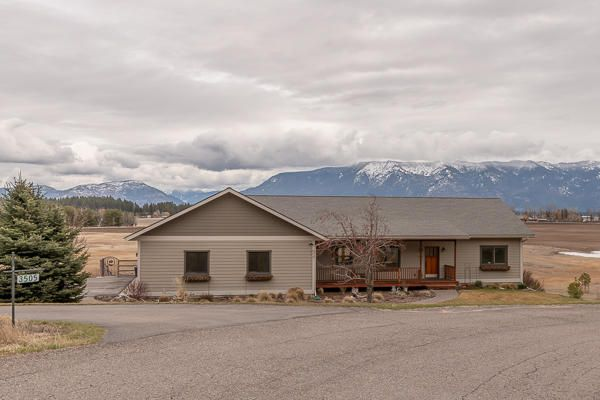 3060 sq. ft., 4 bedrooms, 3 baths, 2.19 acres, main level Master Suite, awesome Swan Mountain views