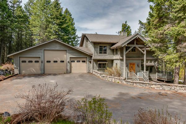 2.94 acres, 2892 sq ft 3 bedrooms, 2.5 baths, 3-car attached, heated garage, 2,000 sq ft 3-bay detached garage/shop/storage building